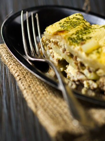 Moussaka is a casserole-type dish made by layering potato rounds and ground beef, which are then baked together and finished off with an egg, milk and sour cream topping.