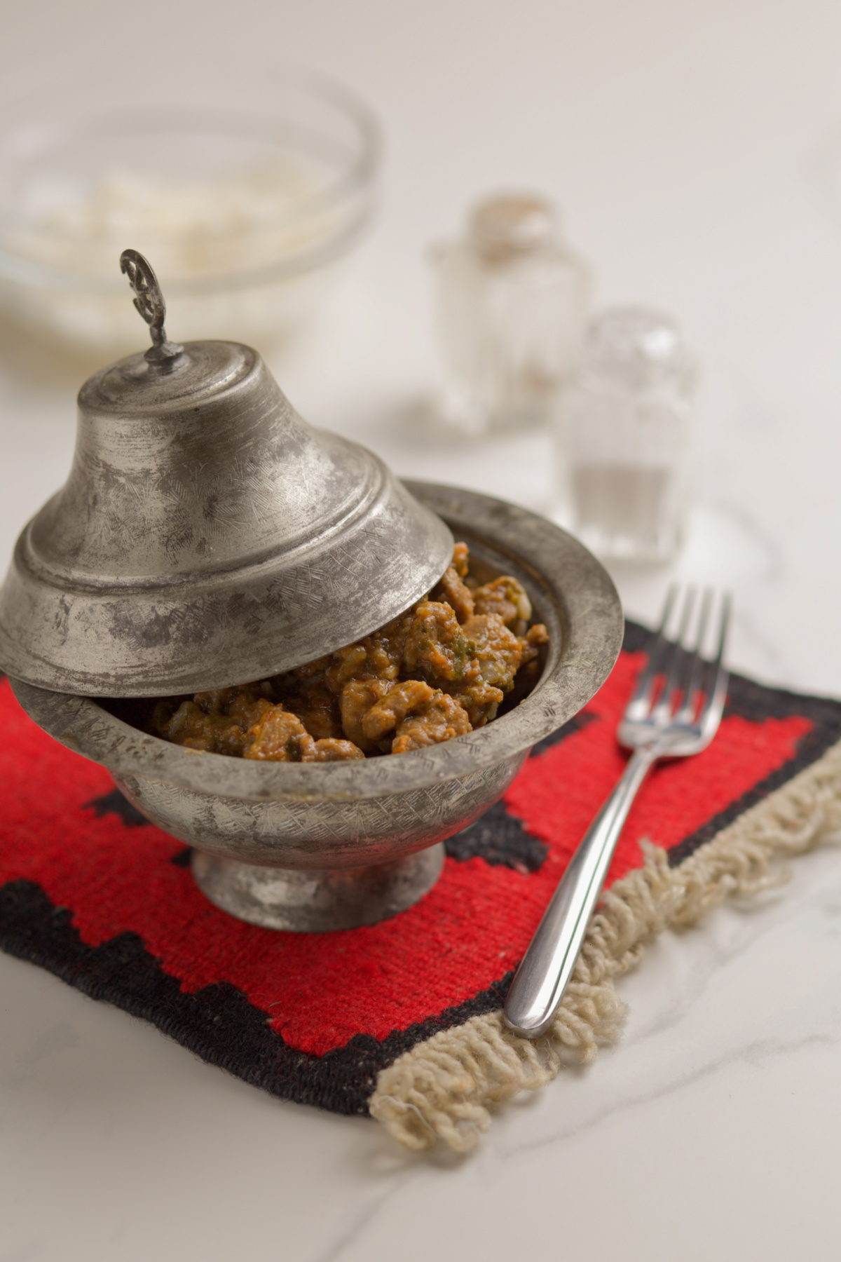 Meat dish served in a traditional bowl sahan.