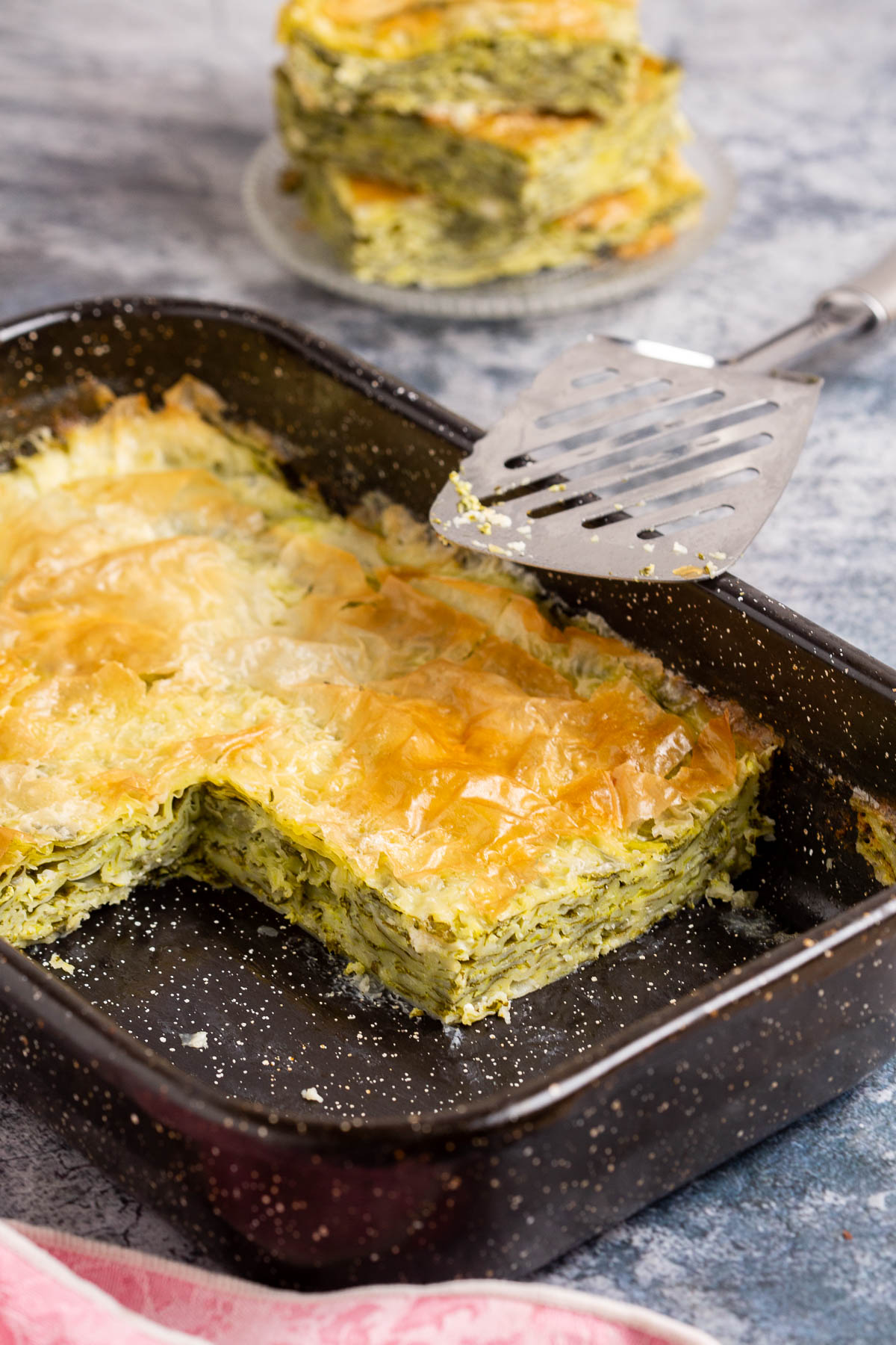 Cheese pie with spinach in a pan.