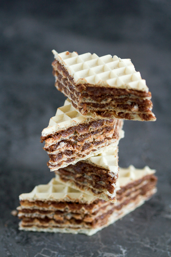 Balkan no bake wafer cake with a nuts, butter and chocolate filling. Crunchy on the outside, but oh-so-soft on the inside.