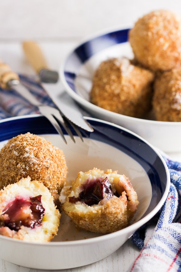 Plums encased in a potato based dumpling dough, boiled and breaded. An old Balkan delicacy.