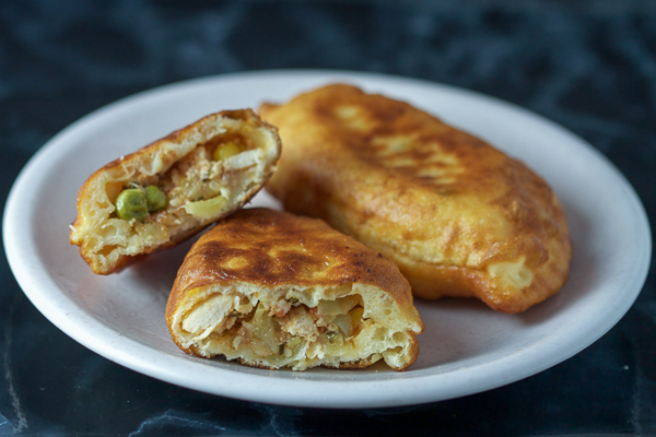 Chicken turnovers: a healthy veggie stuffing (bell peppers, corn, peas and tomatoes), combined with chicken breast, wrapped in dough, and then baked. It's like a salad, main course, and a side all in one.