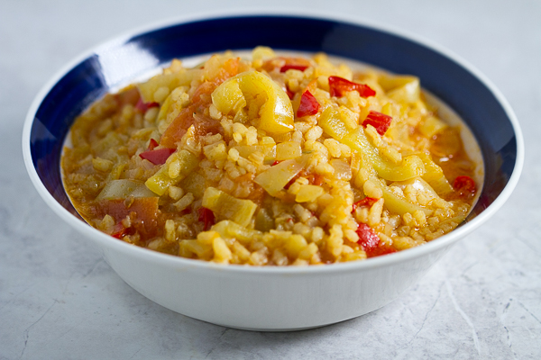 Satarash, or Risotto stir fry: a contemporary take on a classic. Round grain rice simmered in a sauce of bell peppers, yellow onions and tomatoes for a light and filling vegetarian favorite.