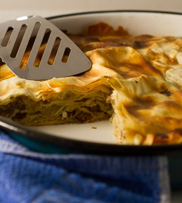 Ground beef phyllo pie. Ground beef (or veal) layered in phyllo sheets softened with butter, then baked until golden. Much pie. Not much fuss.