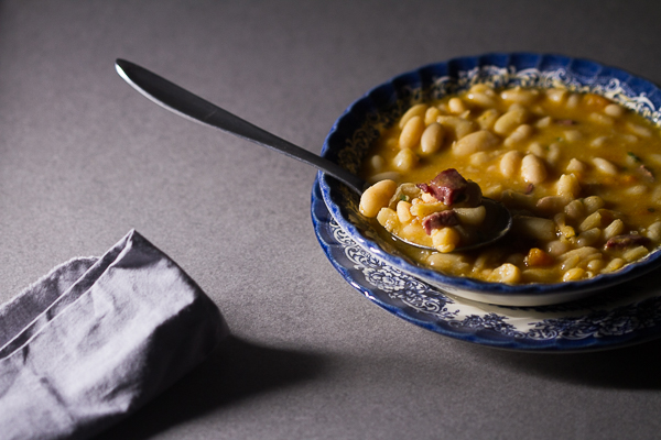 Dry beans soaked, added to simmered vegetables and meat, cooked over low fire, then thickened with a paprika based roux. The result is a delicious thick soup (stew) overflowing with meaty, hearty beans processed to perfection.