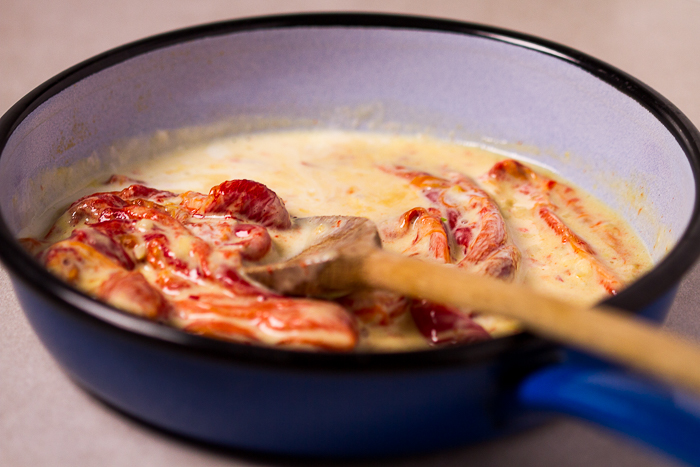 Flawlessly roasted, tender red bull's horn peppers in heavy cream-plus-cheese white sauce... This peppers sauce recipe is achieved by first roasting peppers (you can use bell peppers instead of Italian bull horn peppers) to a soft perfection, and then simmered in heavy cream, garlic and cheese.How perfect is this side dish?