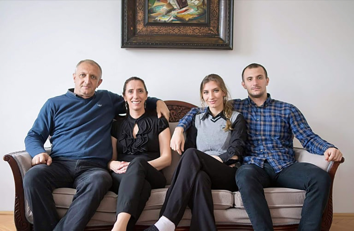 Four adults sitting on a couch.